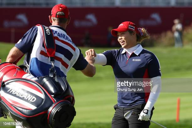 Ariya Jutanugarn of Thailand celebrates her chip-in eagle to win the Wild-Card Playoff on the 14th hole on day four of the UL International Crown at...