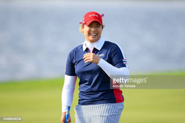 Ariya Jutanugarn of Thailand celebrates on the 17th green after her victory in the Singles match against Sung Hyun Park of South Korea on day four of...
