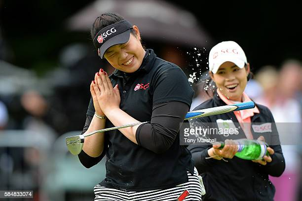 Ariya Jutanugarn of Thailand celebrates victory after holing the winning putt on the 18th green during the final round of the Ricoh Women's British...