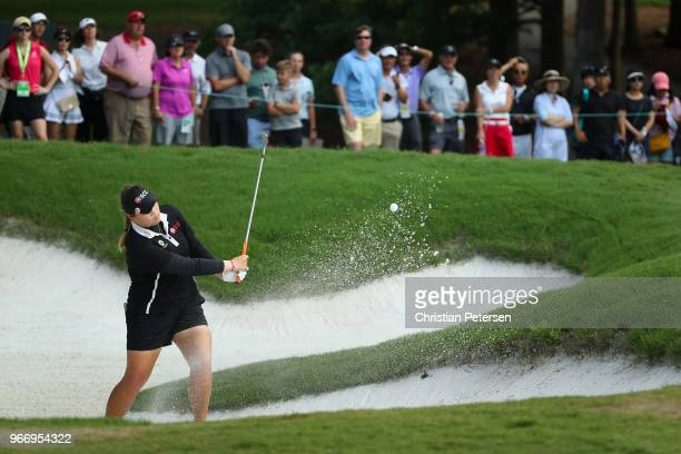 Ariya Jutanugarn of Thailand chips from the bunker on the third playoff hole during the final round of the 2018 US Women's Open at Shoal Creek on...