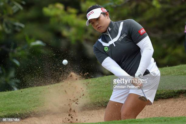 Ariya Jutanugarn of Thailand chips from the bunker onto the eighth green during the first round of the LPGA LOTTE Championship Presented By Hershey...