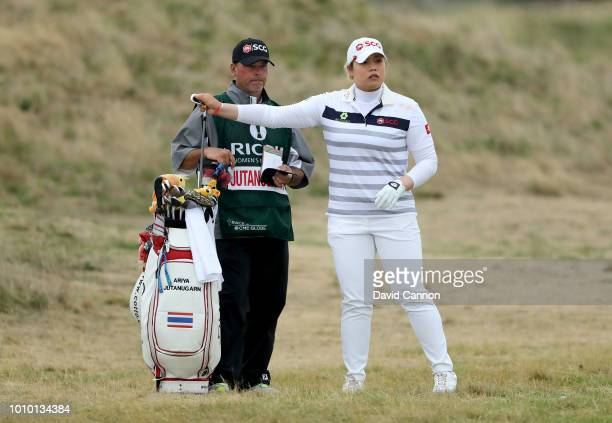 Ariya Jutanugarn of Thailand chooses her club for her second shot on the fourth hole during the second round of the Ricoh Women's British Open at...