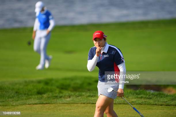 Ariya Jutanugarn of Thailand gestures while walking on the 17th fairway during the Singles match against Sung Hyun Park of South Korea on day four of...