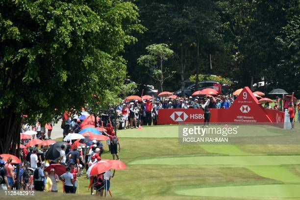 Ariya Jutanugarn of Thailand hits a shot during the final round of the HSBC Women's World Championship at the Sentosa Golf Club in Singapore on March...
