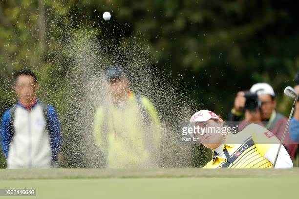 Ariya Jutanugarn of Thailand hits out from a bunker on the 18th green during the first round of the TOTO Japan Classic at Seta Golf Course on...