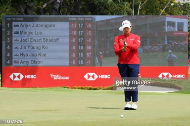 Ariya Jutanugarn of Thailand lines up a putt on the 18th green during the third round of the HSBC Women's World Championship at Sentosa Golf Club on...