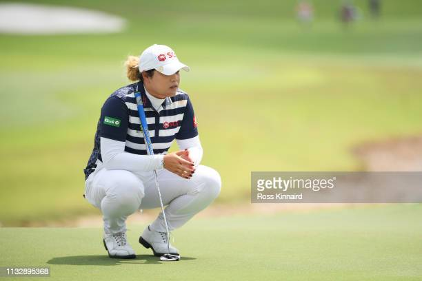 Ariya Jutanugarn of Thailand lines up a putt on the fifth green during the second round of the HSBC Women's World Championship at Sentosa Golf Club...