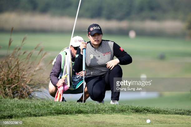 Ariya Jutanugarn of Thailand looks over a green on the 6th green during the third round of the LPGA KEB Hana Bank Championship at Sky 72 Golf Club on...