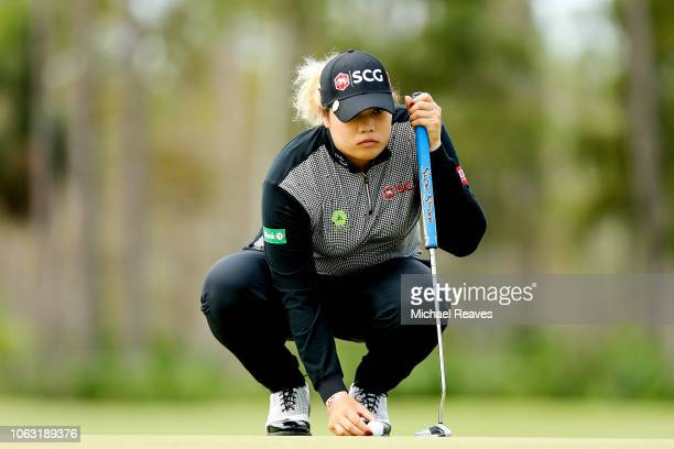 Ariya Jutanugarn of Thailand looks over a putt on the first green during the final round of the LPGA CME Group Tour Championship at Tiburon Golf Club...