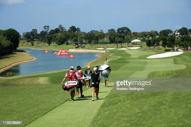 Ariya Jutanugarn of Thailand Minjee Lee of Australia and Jodi Ewart Shadoff of England walk on the fifth hole during the final round of the HSBC...