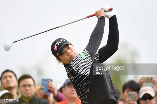 Ariya Jutanugarn of Thailand plays a shot the final round of the Buick LPGA Shanghai 2018 at Shanghai Qizhong Garden Golf Club on October 21 2018 in...