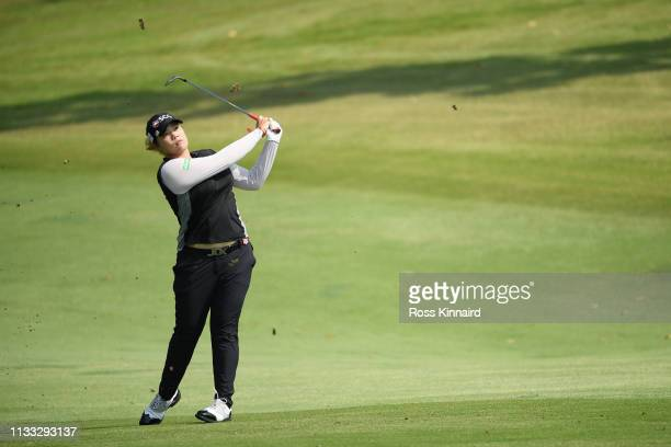 Ariya Jutanugarn of Thailand plays her second shot on the second hole during the final round of the HSBC Women's World Championship at Sentosa Golf...