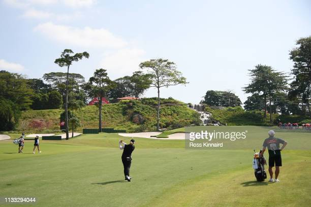 Ariya Jutanugarn of Thailand plays her second shot on the third hole during the final round of the HSBC Women's World Championship at Sentosa Golf...