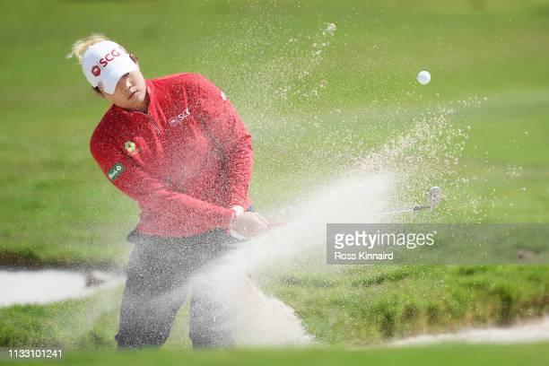 Ariya Jutanugarn of Thailand plays her third shot on the fifth hole during the third round of the HSBC Women's World Championship at Sentosa Golf...