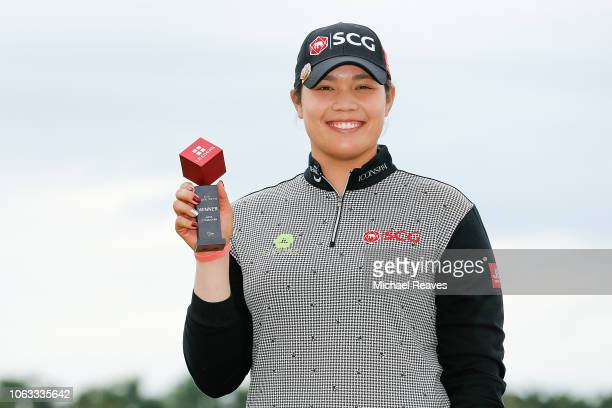 Ariya Jutanugarn of Thailand poses for a photo with the Leaders' Top 10 Competition trophy after the final round of the LPGA CME Group Tour...