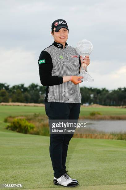 Ariya Jutanugarn of Thailand poses for a photo with the Race to the CME Globe trophy after the final round of the LPGA CME Group Tour Championship at...