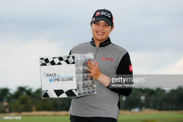 Ariya Jutanugarn of Thailand poses for a photo with the Race to the CME Globe Money Box after the final round of the LPGA CME Group Tour Championship...