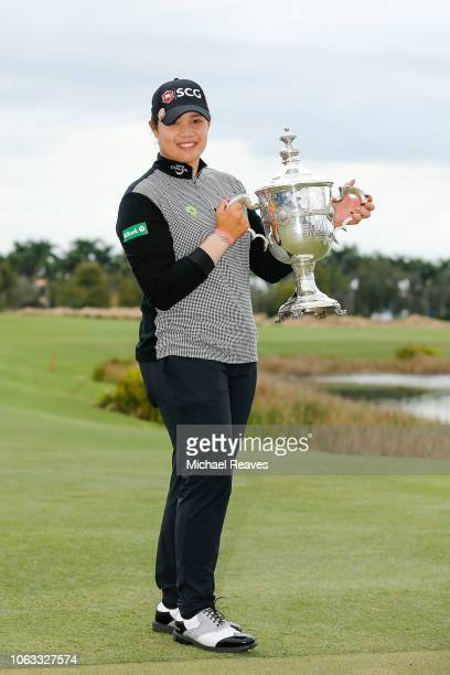 Ariya Jutanugarn of Thailand poses for a photo with the Rolex Player of the Year trophy after the final round of the LPGA CME Group Tour Championship...