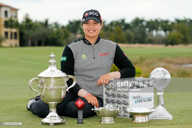 Ariya Jutanugarn of Thailand poses for a photo with the Rolex Player of the Year trophy Leaders Top 10 Competition Trophy Vare trophy Rolex Annika...