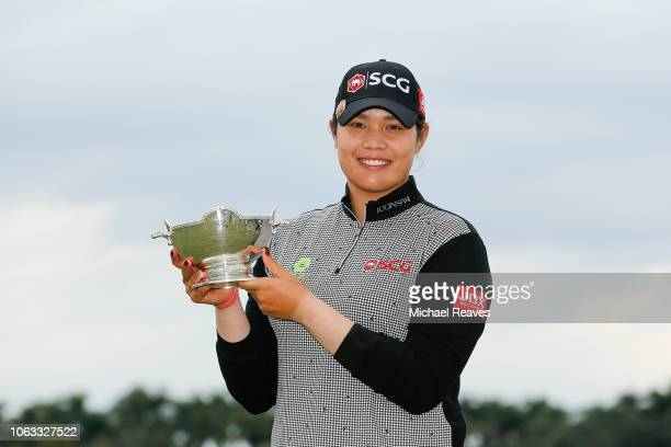 Ariya Jutanugarn of Thailand poses for a photo with the Vare Trophy after the final round of the LPGA CME Group Tour Championship at Tiburon Golf...