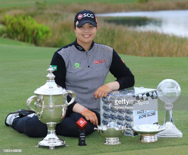 Ariya Jutanugarn of Thailand poses with her trophies at Tiburon Golf Club in Naples Florida on Nov 18 after winning the Player of the Year title the...