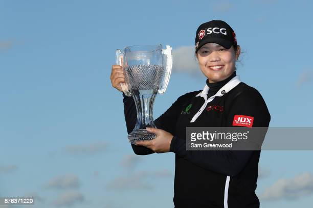 Ariya Jutanugarn of Thailand poses with the CME Group Tour Championship trophy after the final round of the CME Group Tour Championship at the...