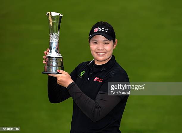 Ariya Jutanugarn of Thailand poses with the trophy after winning the Ricoh Women's British Open Day Four at Woburn Golf Club on July 31 2016 in...