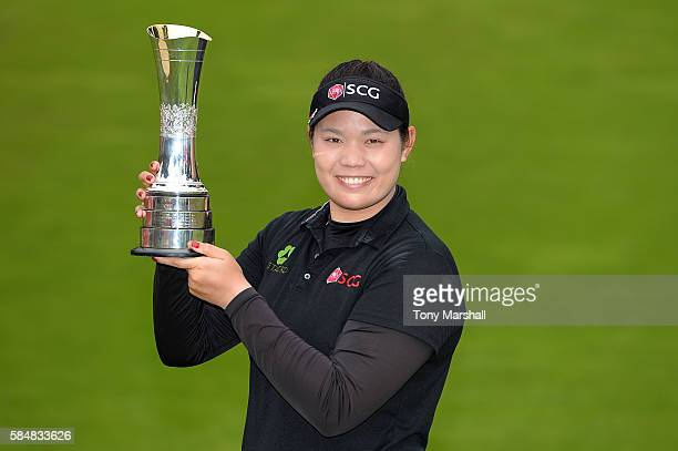 Ariya Jutanugarn of Thailand poses with the trophy following her victory during the final round of the Ricoh Women's British Open at Woburn Golf Club...