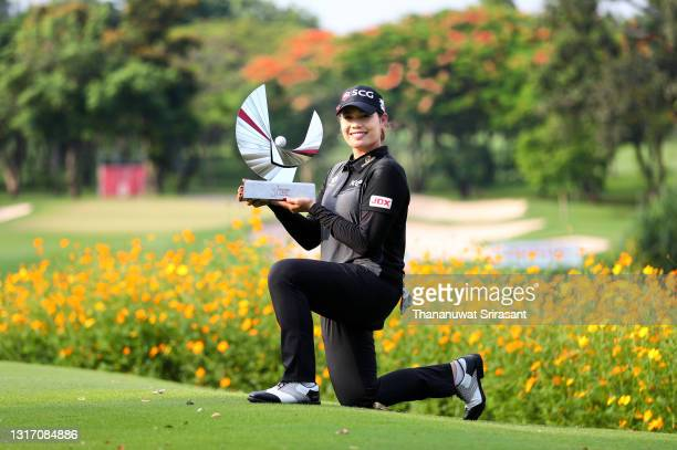 Ariya Jutanugarn of Thailand poses with the trophy on the 8th green after winning the Honda LPGA Thailand at the Siam Country Club Pattaya Old Course...
