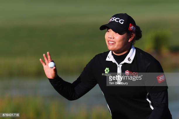Ariya Jutanugarn of Thailand reacts after making a birdie putt on the 18th green to win the CME Group Tour Championship at the Tiburon Golf Club on...