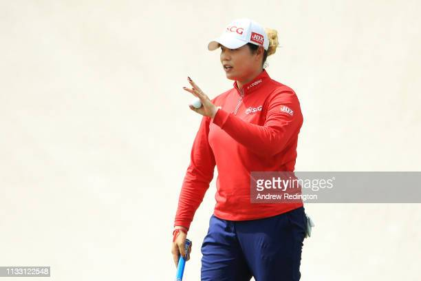 Ariya Jutanugarn of Thailand reacts on the 18th green during the third round of the HSBC Women's World Championship at Sentosa Golf Club on March 02...