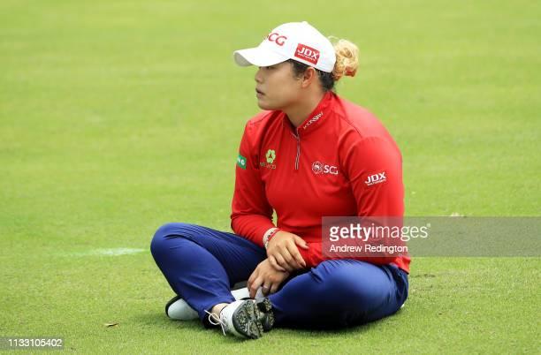 Ariya Jutanugarn of Thailand sits on the eighth fairway during the third round of the HSBC Women's World Championship at Sentosa Golf Club on March...