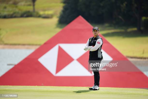 Ariya Jutanugarn of Thailand stands on the fifth green during the final round of the HSBC Women's World Championship at Sentosa Golf Club on March 03...