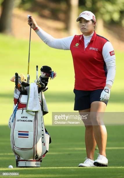 Ariya Jutanugarn of Thailand takes a club from her bag on the 11th hole during the third round of the 2018 US Women's Open at Shoal Creek on June 2...