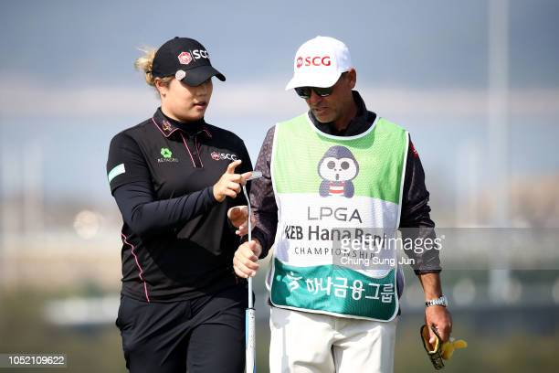 Ariya Jutanugarn of Thailand talks with her caddie after a putt on the 6th hole during the final round of the LPGA KEB Hana Bank Championship at Sky...