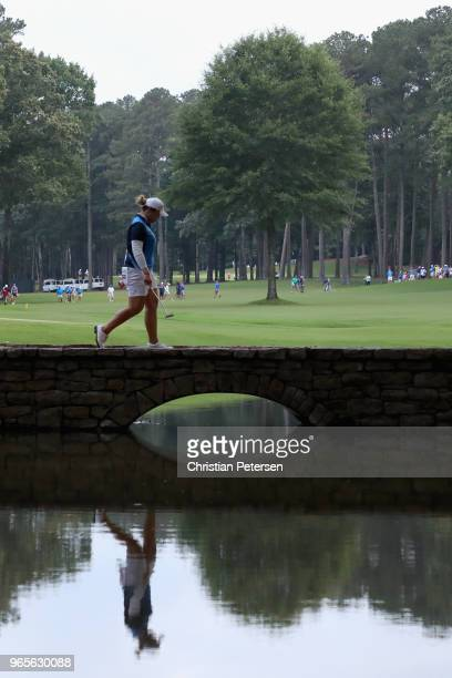 Ariya Jutanugarn of Thailand walks over a bridge off the sixth green during the second round of the 2018 US Women's Open at Shoal Creek on June 1...