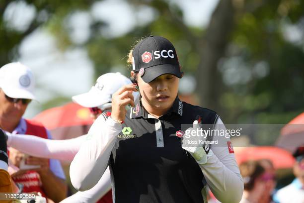 Ariya Jutanugarn of Thailand walks to the first tee during the final round of the HSBC Women's World Championship at Sentosa Golf Club on March 03...