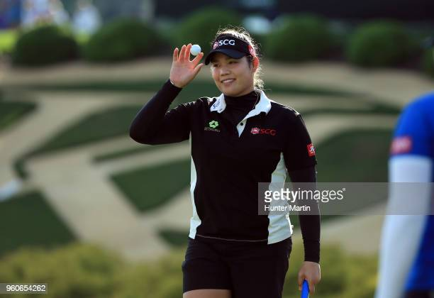 Ariya Jutanugarn of Thailand waves to the crowd after putting out on the 18th hole during the Kingsmill Championship presented by Geico on the River...
