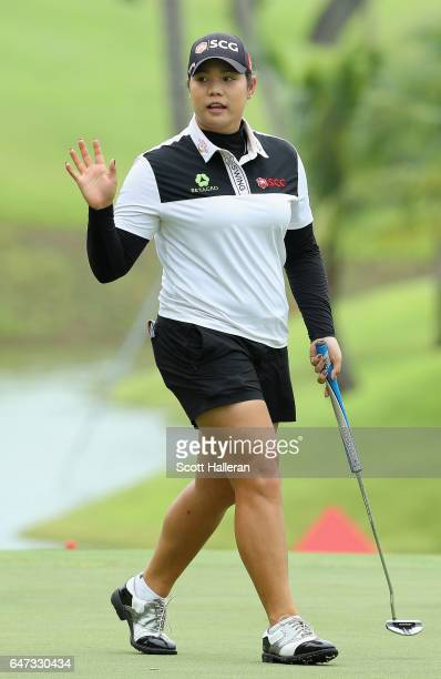 Ariya Jutanugarn of Thailand waves to the crowd during the second round of the HSBC Women's Champions on the Tanjong Course at Sentosa Golf Club on...