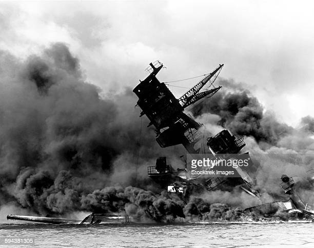uss arizona burning after the japanese attack on pearl harbor. - uss arizona stock photos and pictures