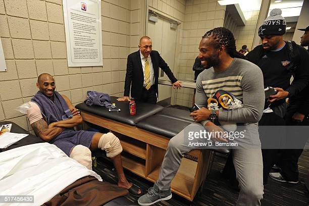 Arizona Cardinal Larry Fitzgerald talks to Kobe Bryant of the Los Angeles Lakers after the game against the Phoenix Suns in the locker room on March...