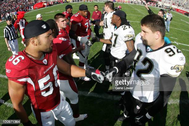 Arizona Cardinals and Jacksonville Jaquars players shake hands before a game at Sun Devil Stadium in Tempe AZ on November 27 2005 The Cardinals lost...