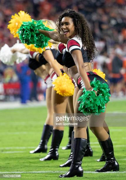 Arizona Cardinals cheerleaders dance on the field during NFL football game between the Arizona Cardinals and the Denver Broncos on October 18 2018 at...