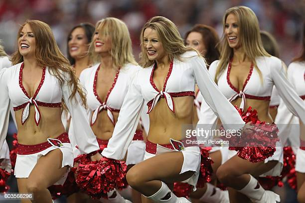 Arizona Cardinals cheerleaders perform during the NFL game against the New England Patriots at the University of Phoenix Stadium on September 11 2016...