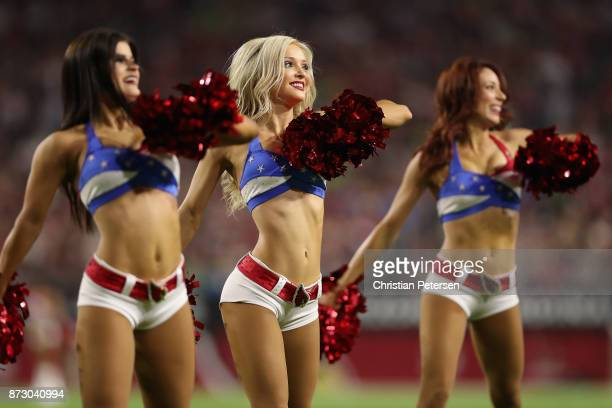 Arizona Cardinals cheerleaders perform during the NFL game against the Seattle Seahawks at the University of Phoenix Stadium on November 9 2017 in...