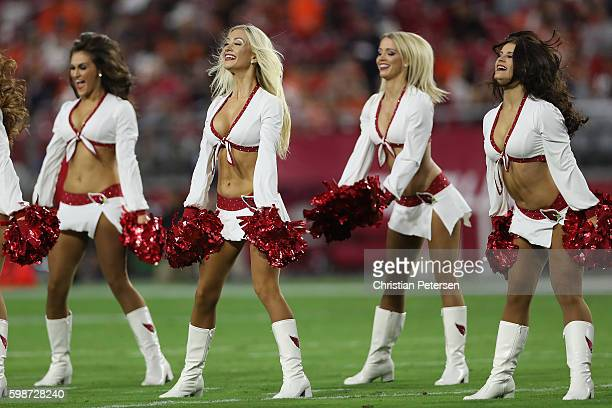 Arizona Cardinals cheerleaders perform during the preseaon NFL game against the Denver Broncos at the University of Phoenix Stadium on September 1...