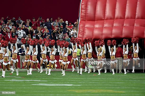 Arizona Cardinals cheerleaders run onto the field prior to the NFL game against the Seattle Seahawks at University of Phoenix Stadium on January 3...