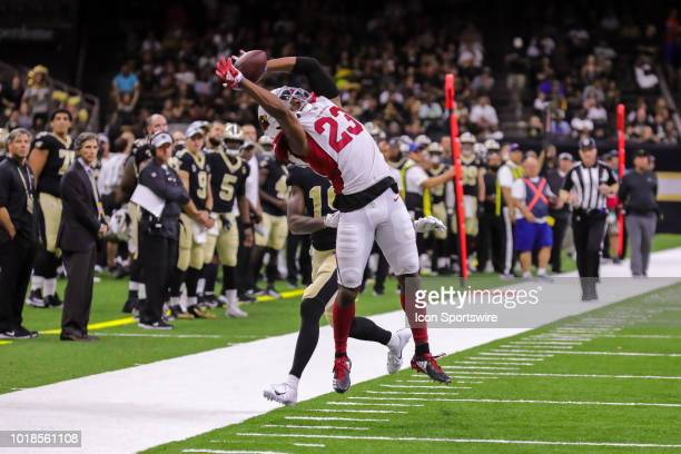 Arizona Cardinals defensive back Bene' Benwikere intercepts a pass by New Orleans Saints quarterback Taysom Hill in an NFL preseason football game...