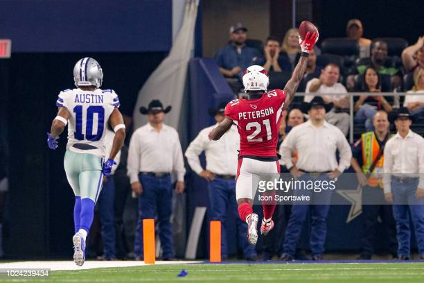 Arizona Cardinals defensive back Patrick Peterson high steps into the end zone for a touchdown after intercepting a pass during the preseason...