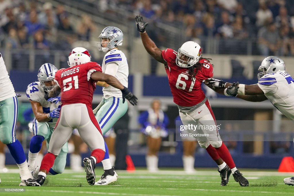 Arizona Cardinals defensive end Cap Capi strips the ball loose from ... 8504d75ce828